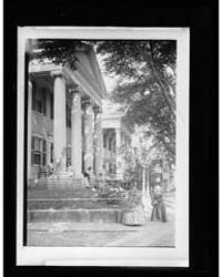 Mansion Portico with Costumed Ladies, Po... by Library of Congress