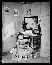 Corner of Living Room in Home of Agricul... by Library of Congress