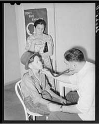 Doctor at Clinic Examining Son of Agricu... by Library of Congress