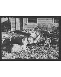 Leaves Drift Down on Unused Farm Equipme... by Library of Congress