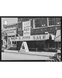 Signs on Store Window Advertising Sales ... by Library of Congress